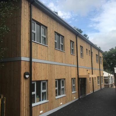 Vertical European red wood timber cladding